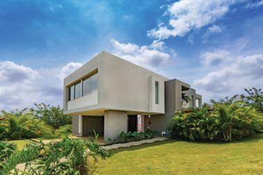 外墙砂浆应用在现代住宅与草和蓝天
