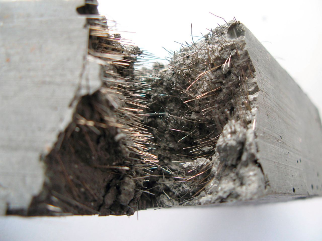 Fiber reinforced concrete block cut in half