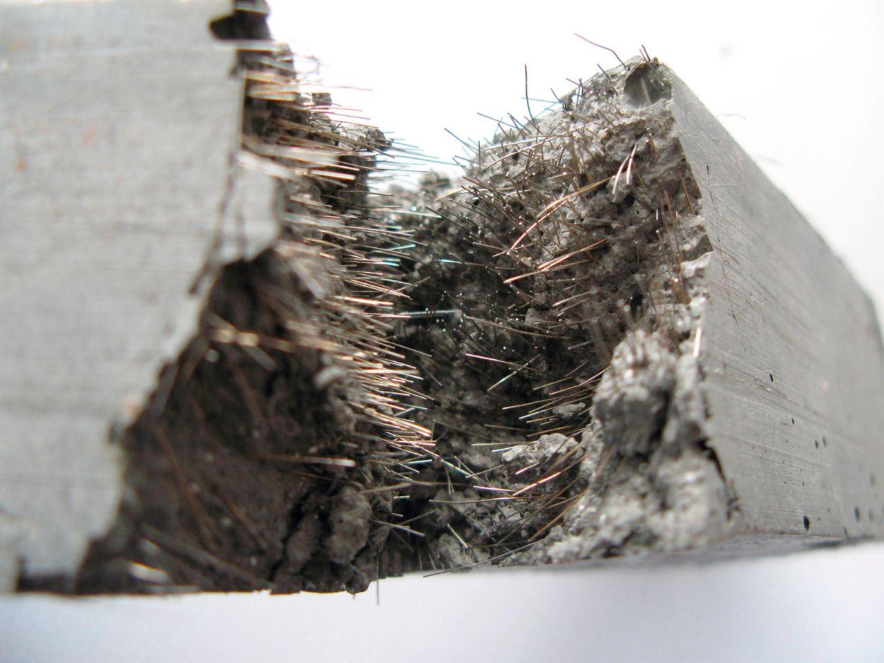 Fiber reinforced concrete block cut in half