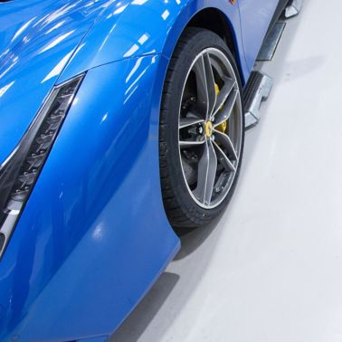 Blue Ferrari car on high gloss Sikafloor surface