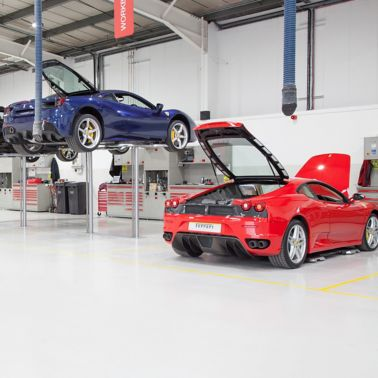 Ferrari cars in repair workshop parked on floor coated with Sika Multidur system