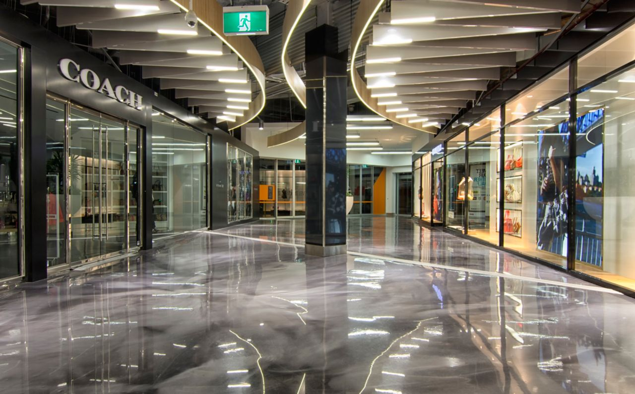 The interior of a shopping plaza showing a decorative reflective floor