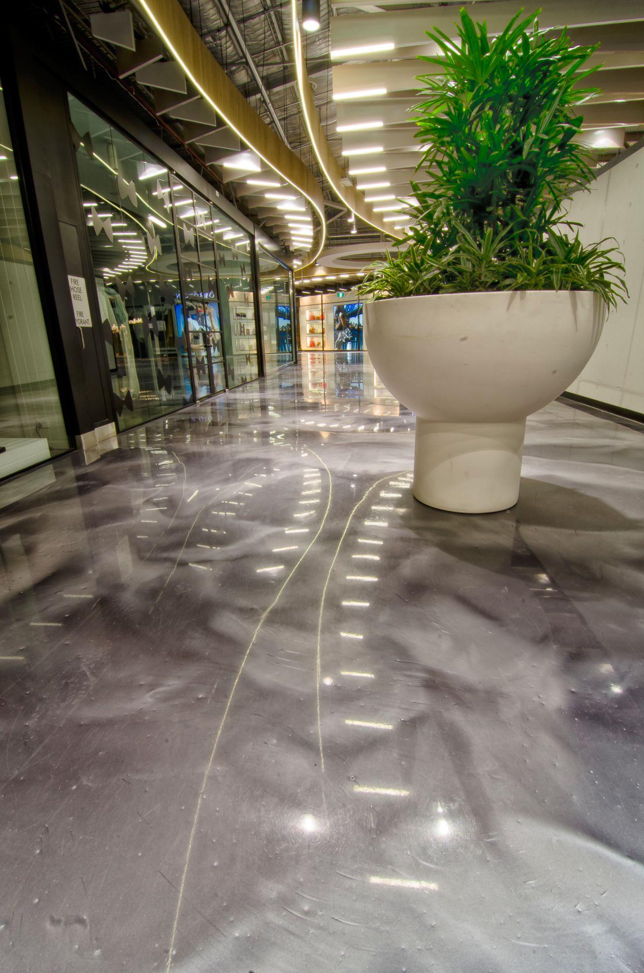 White plant vase on metallic floor in DFO Homebush shopping center