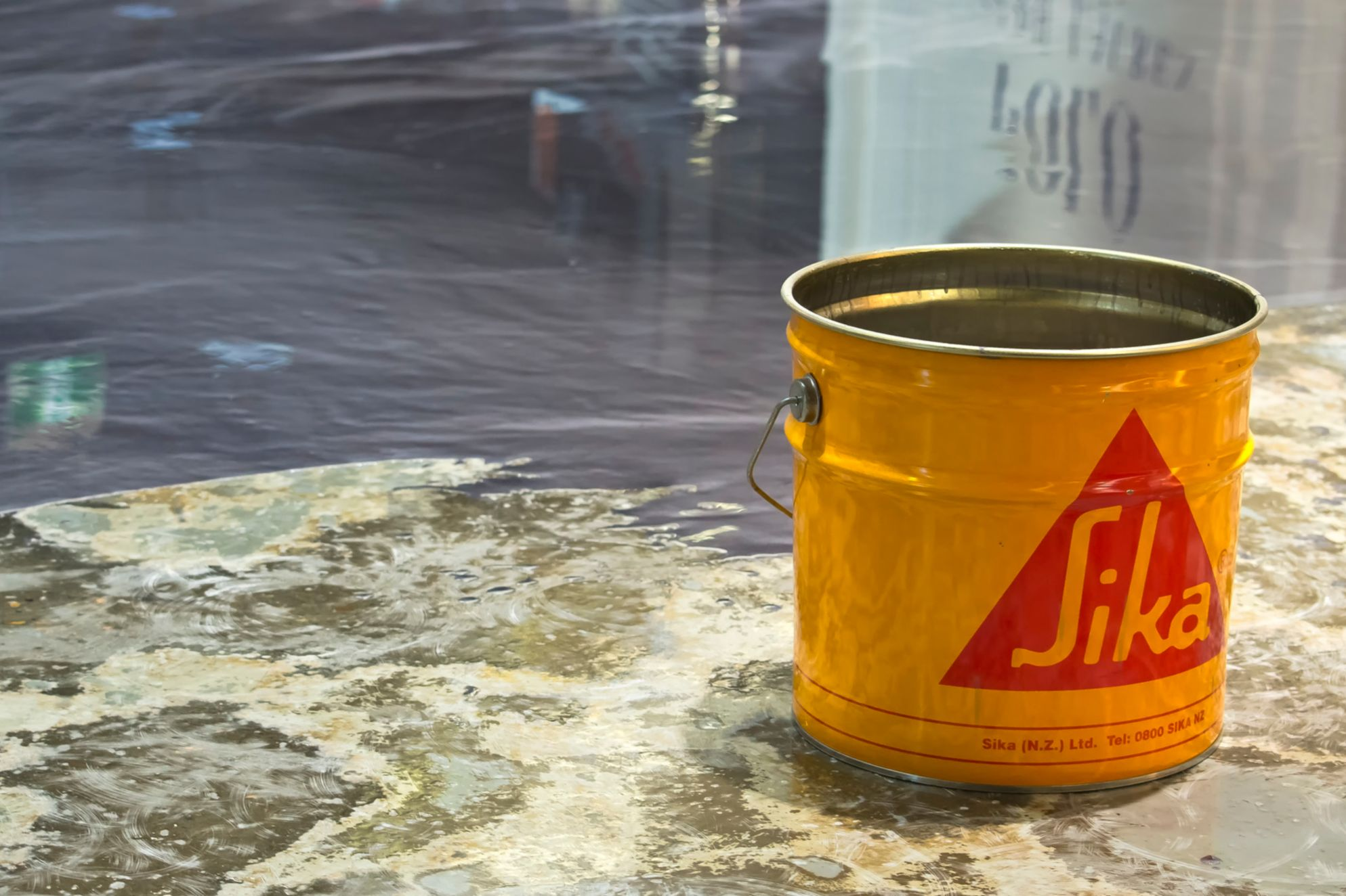 Yellow bucket with Sikafloor and metallic effect floor