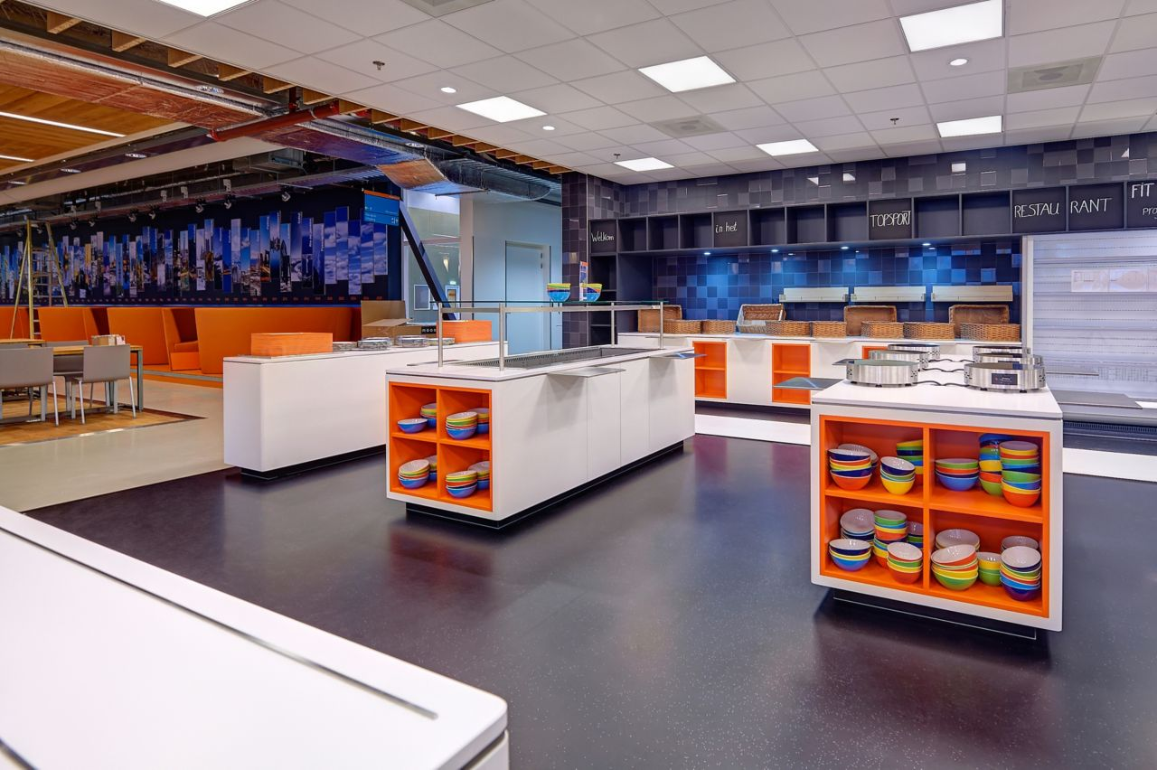 Sales room kitchen restaurant showcase with decorative floor and orange shelves with bowls