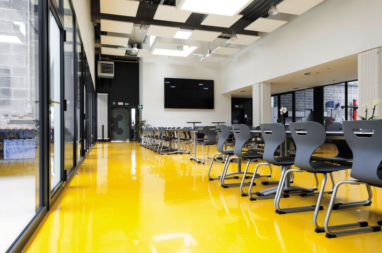 Sika ComfortFloor® yellow floor at school cafeteria