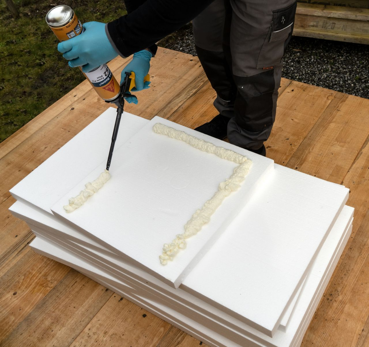 Man applying foam adhesive