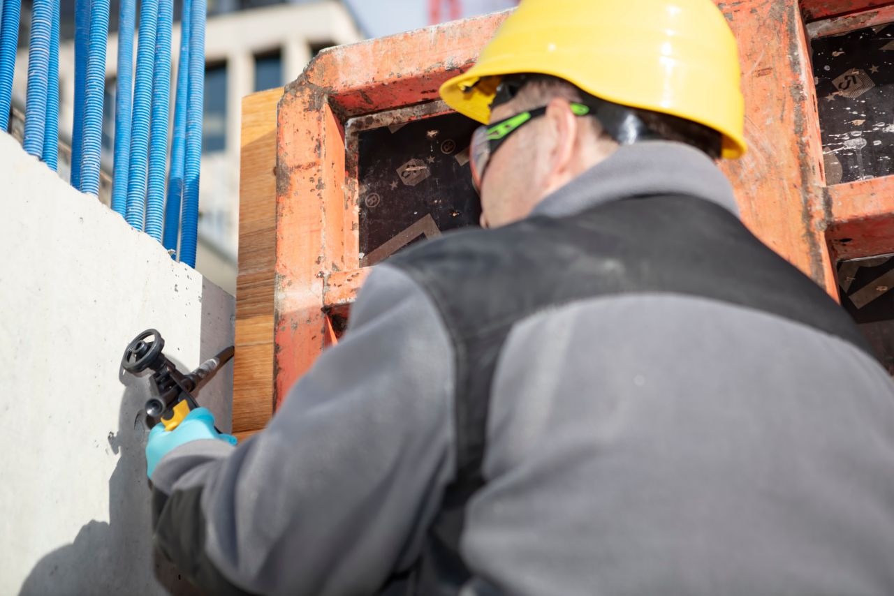 Man applying Sika foams at a construction