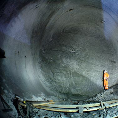 Construction worker standing  inside Gotthard Tunnel in Switzerland