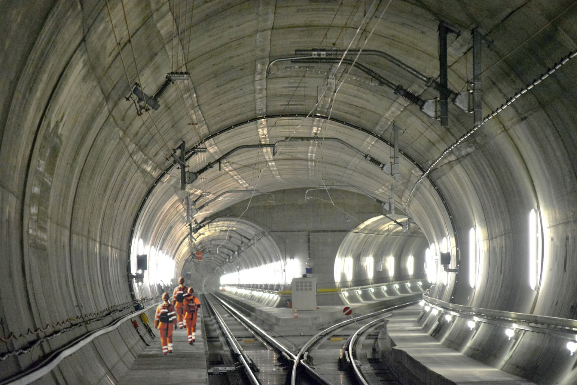 Construction workers walking inside Gotthard Tunnel in Switzerland
