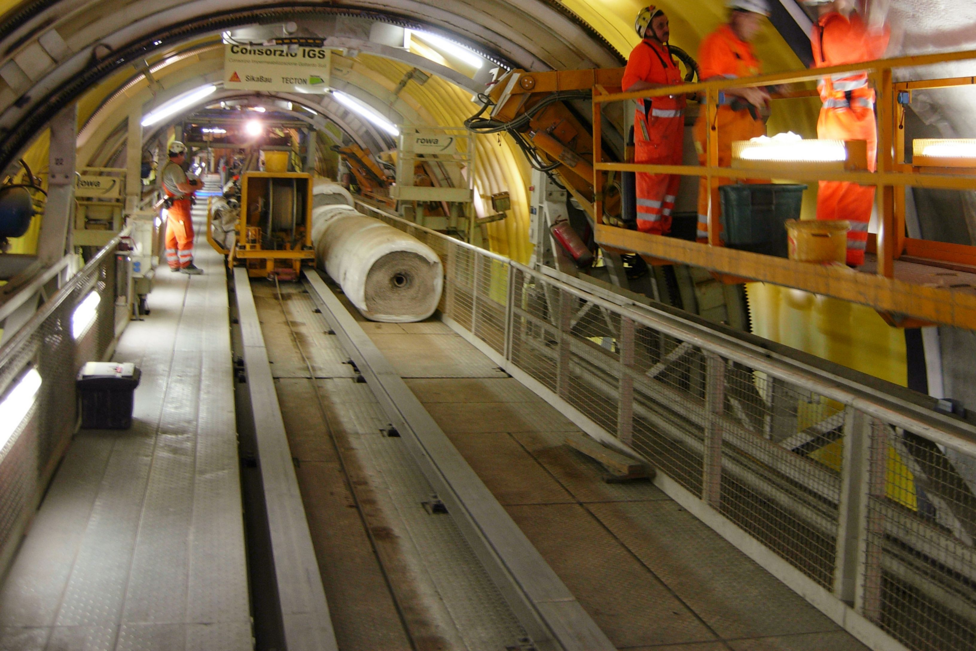 Construction workers waterproofing Gotthard Tunnel in Switzerland with Sikaplan membranes
