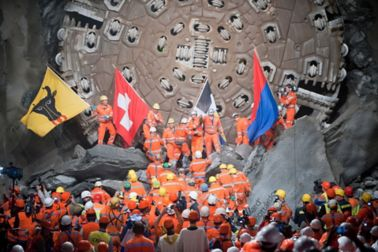 Workers celebrating the tunnel breakthrough in Gotthard Base Tunnel