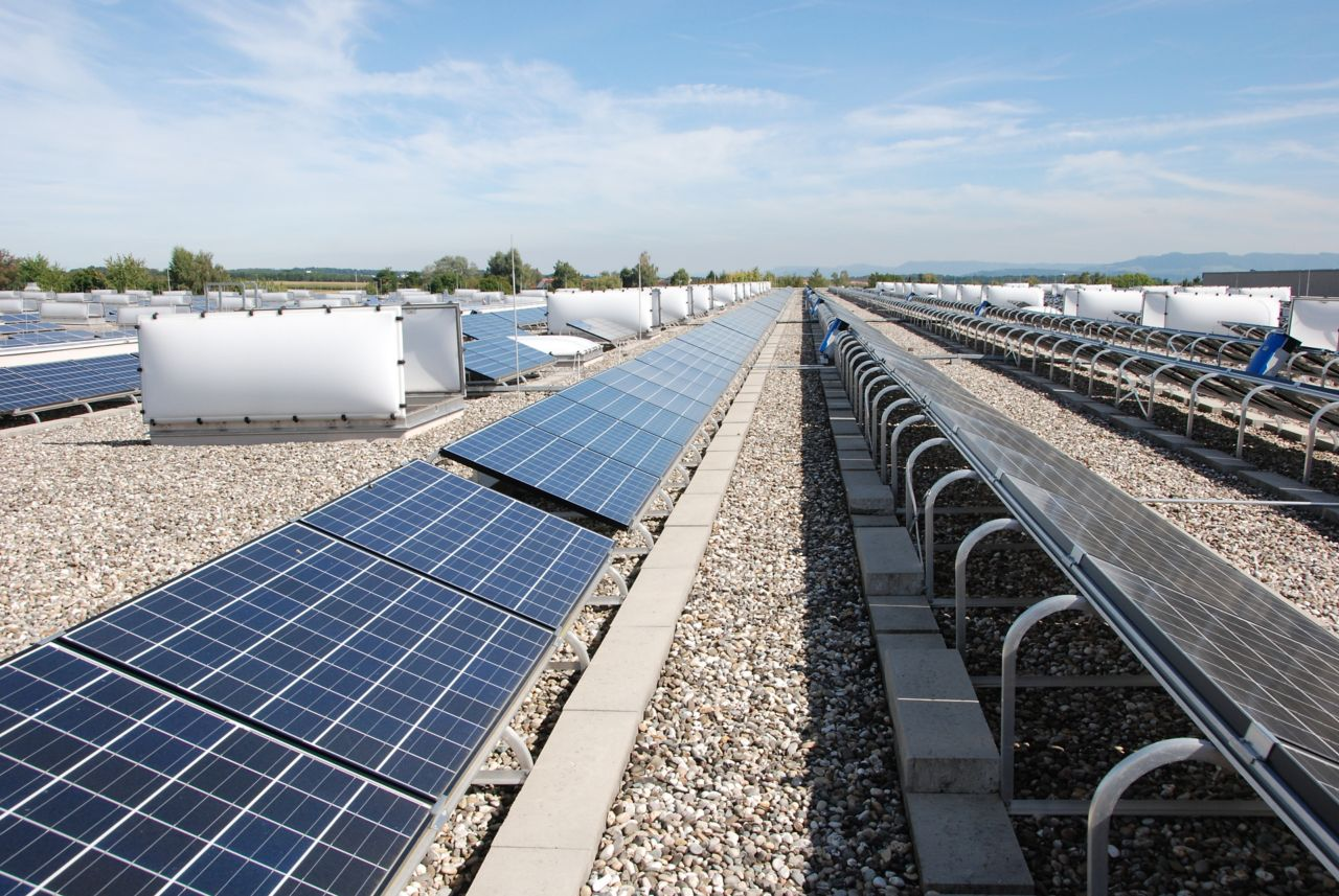 Solar panels on gravel ballasted roof with single ply membranes