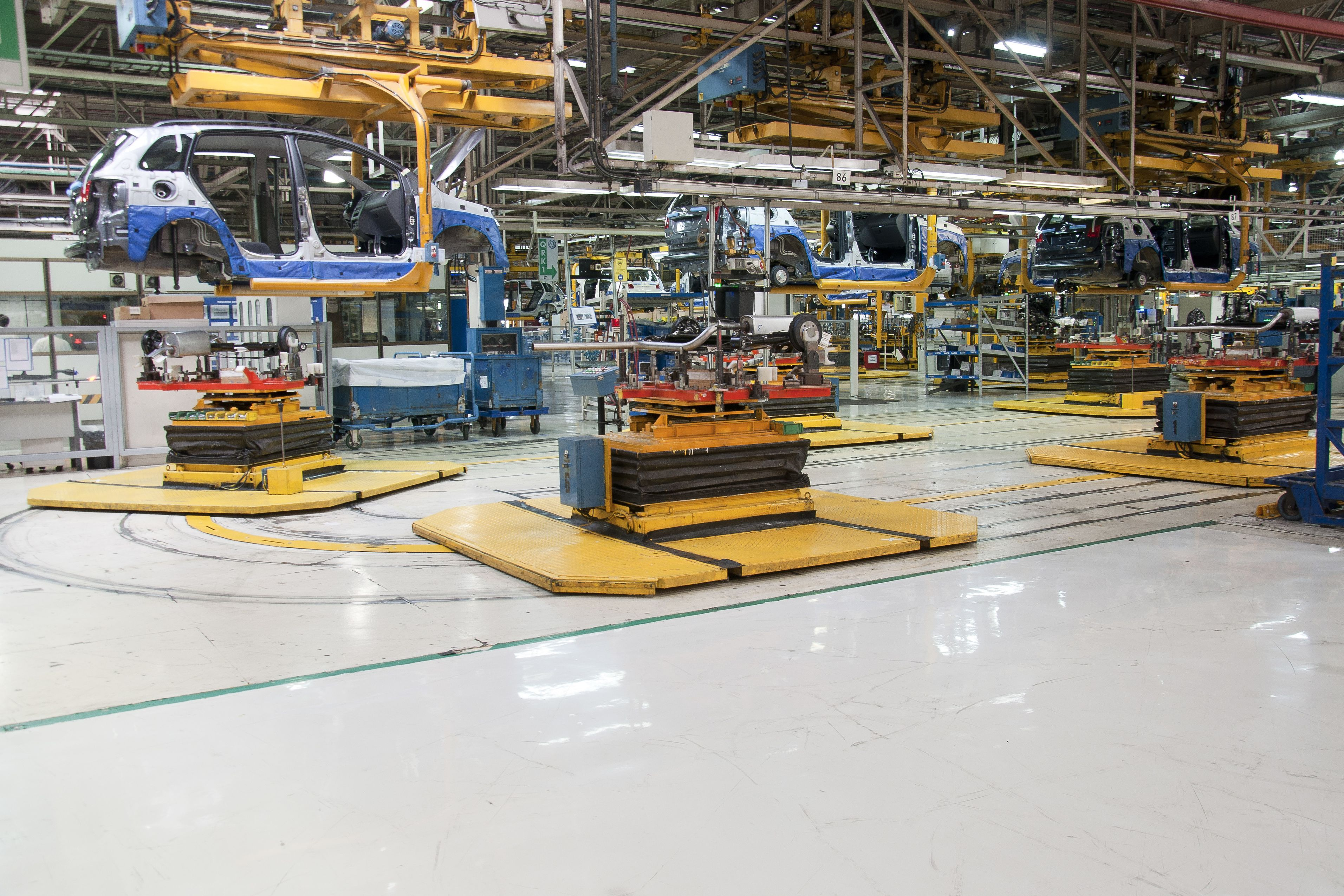 Industrial floor coating with Sikafloor resin cementitious flooring system in car production plant