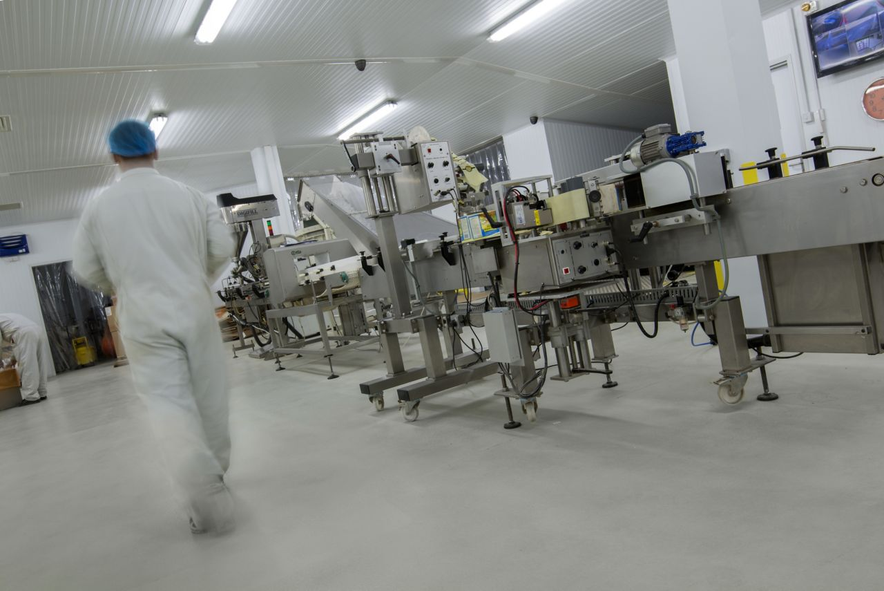 Industrial floor coating with Sikafloor resin cementitious flooring system in food facility