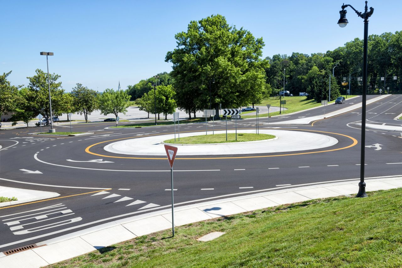 Road roundabout with trees and grass