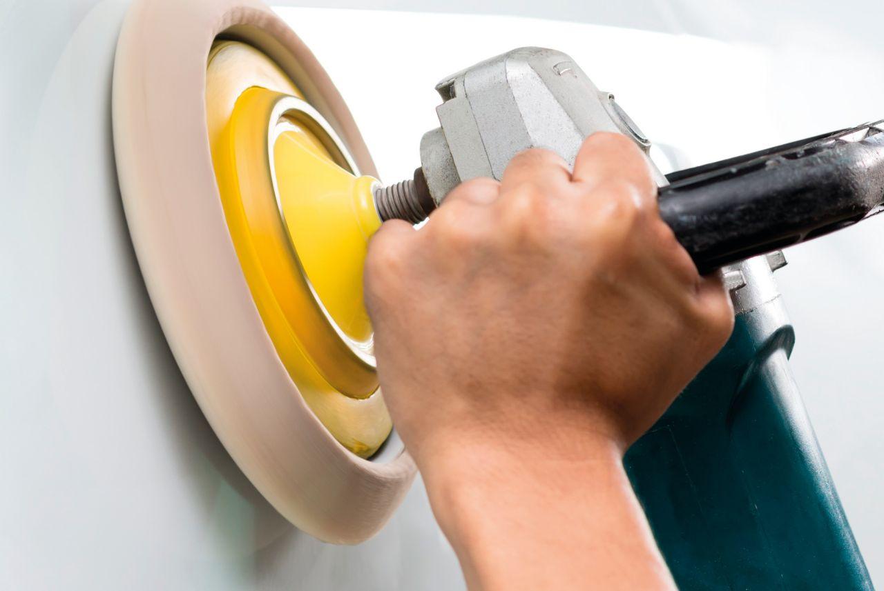 Man using abrasive tool