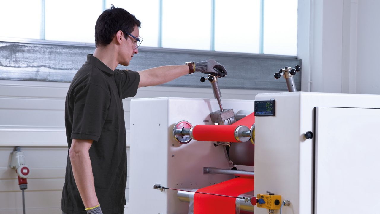 Man using inhouse testing equipment to produce technical textile