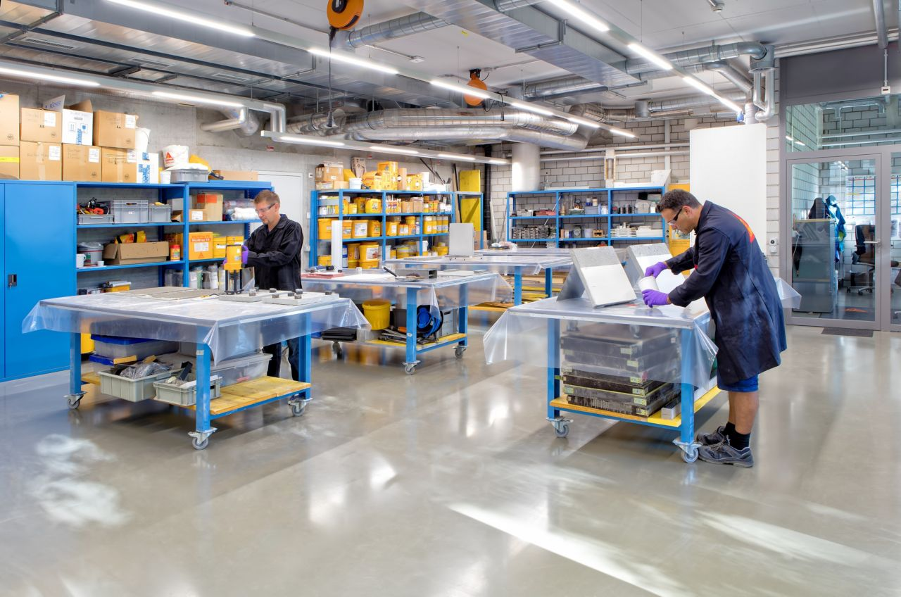 Sika employees working in a lab in Sika office building in Zurich