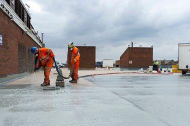 2 men applying Liquid Membrane
