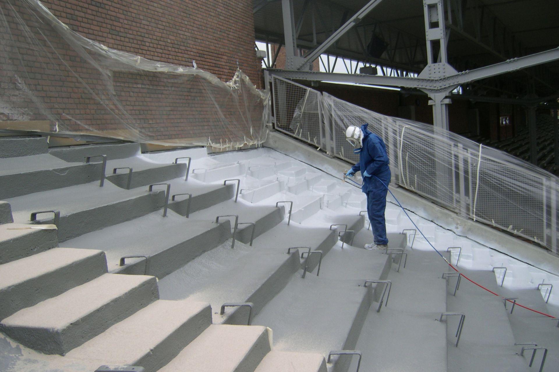 Man applying liquid membrane