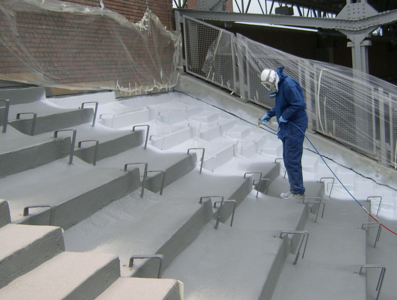 Man applying liquid membrane