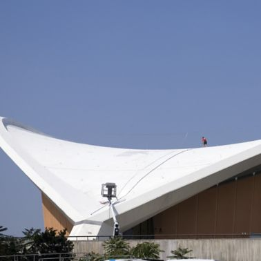 Construction worker applying Sikalastic liquid applied membrane on Congress Hall roof in Berlin Germany