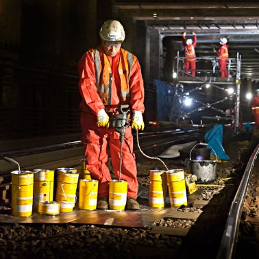 Construction worker with Sika products in London underground tunnel