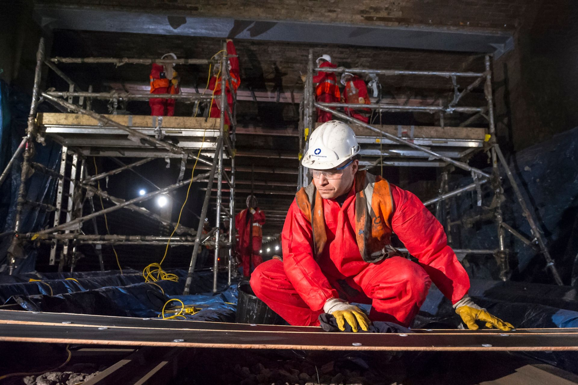 Construction worker prepares Sika Carbodur CFRP strengthening plates