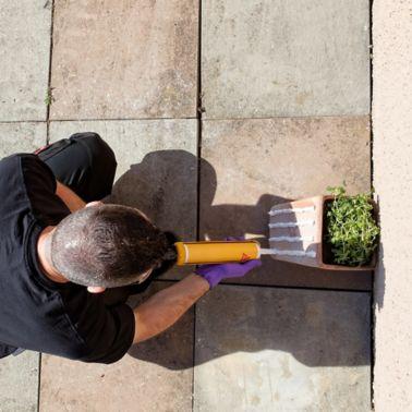 Man Applying Construction Adhesive