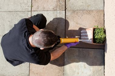 Man Applying Construction Adhesive