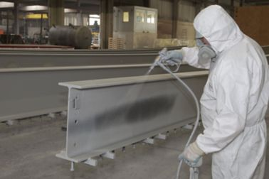 Man Applying Fire Resistant Coating on a  load-bearing structure