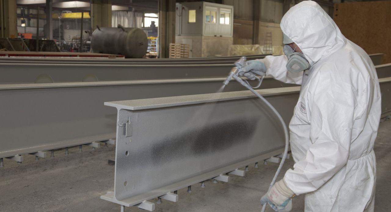 Man Applying Fire Resistant Coating