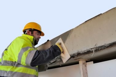 Man repairing concrete bridge with Sika repair mortar