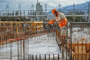 Worker man spraying concrete surface with Sika® Antisol® concrete curing compound