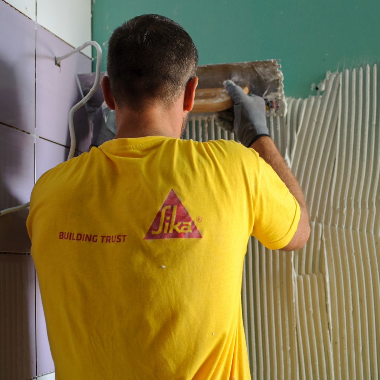 Man tiling at the Epirus Sport and Health Center in Ioannina, Greece