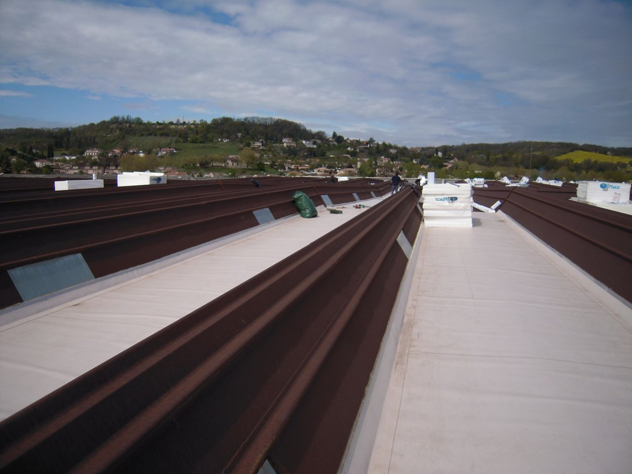 Metal roof after renovation repair with single ply roof membrane