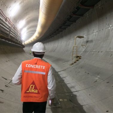 Engineer walking in the metro tunnel of Quito, Ecuador