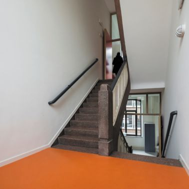 Sika ComfortFloor® orange floor at stair case at Notre Dame Namur school