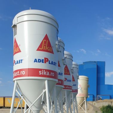 Adeplast co-branded silos.