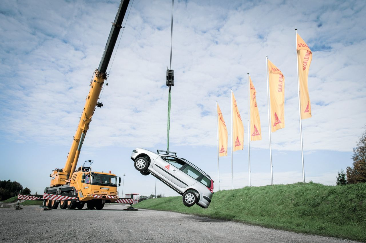 Car being lifted with a crane from the car windshield