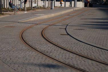 Rail fixing tram track embedded into cobblestone street in Zurich, Switzerland