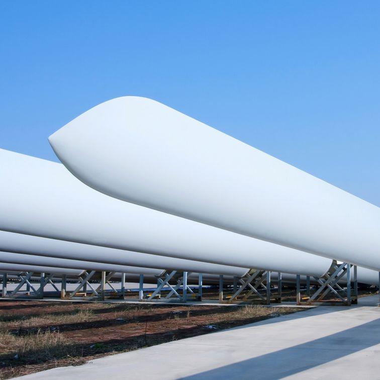 Wind turbine blades on tripods ready to be mounted
