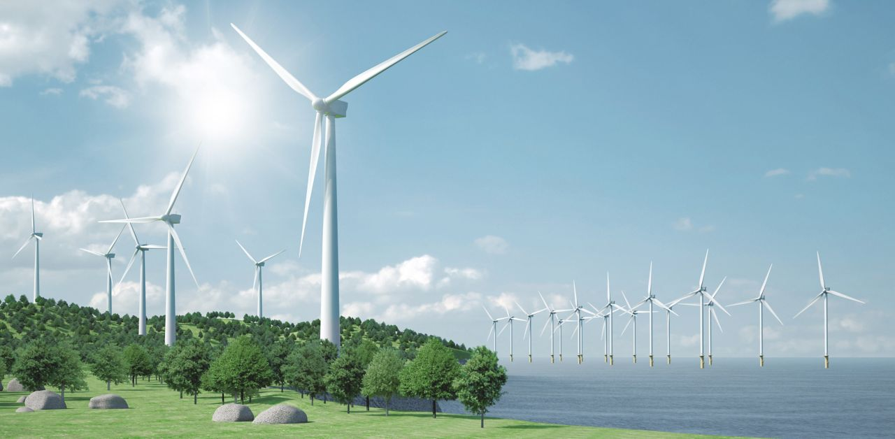 Wind energy farm with onshore and offshore turbines