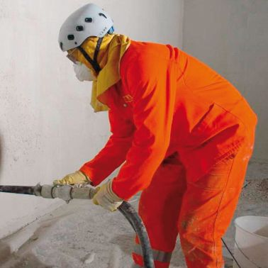 Man spraying mortar on the wall