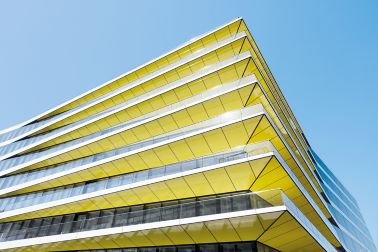 Modern commercial building with yellow panel parts