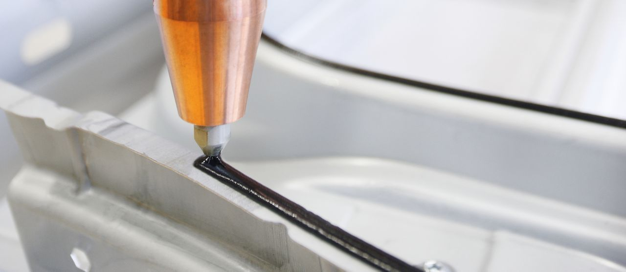 Application of adhesive with a robot