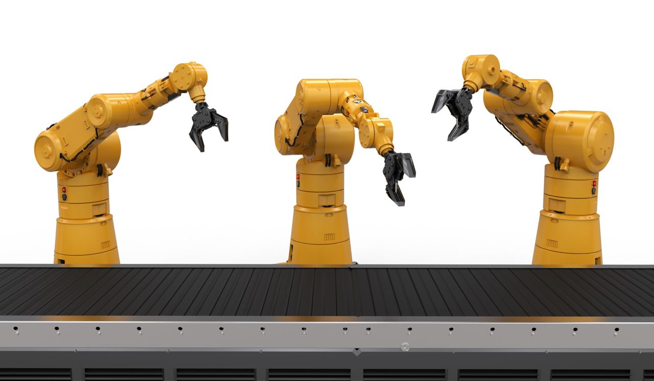 Industrial robotic arms with conveyor belt assembly line