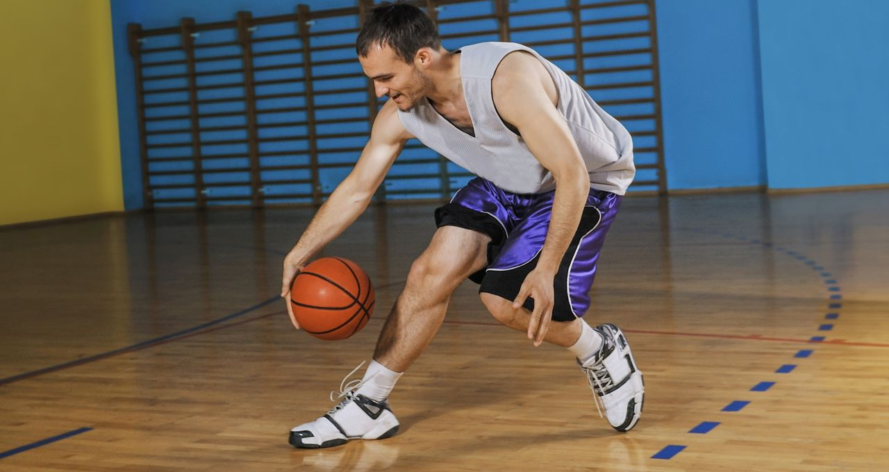 Basket ball player playing on soft laminated sandwich panel floor