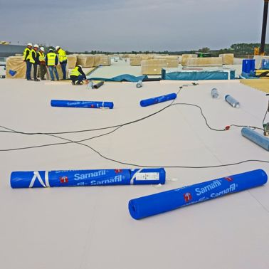 Applying Sika Sarnafil waterproofing membrane on all roofing areas on Volkswagen Plant in Wrzesnia